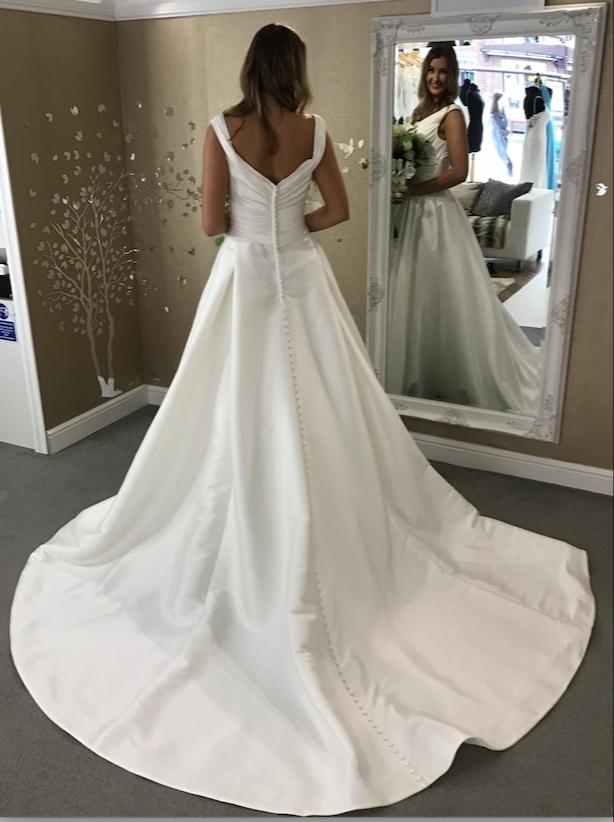 Beautiful bride in a dress by the designer Ronald Joyce