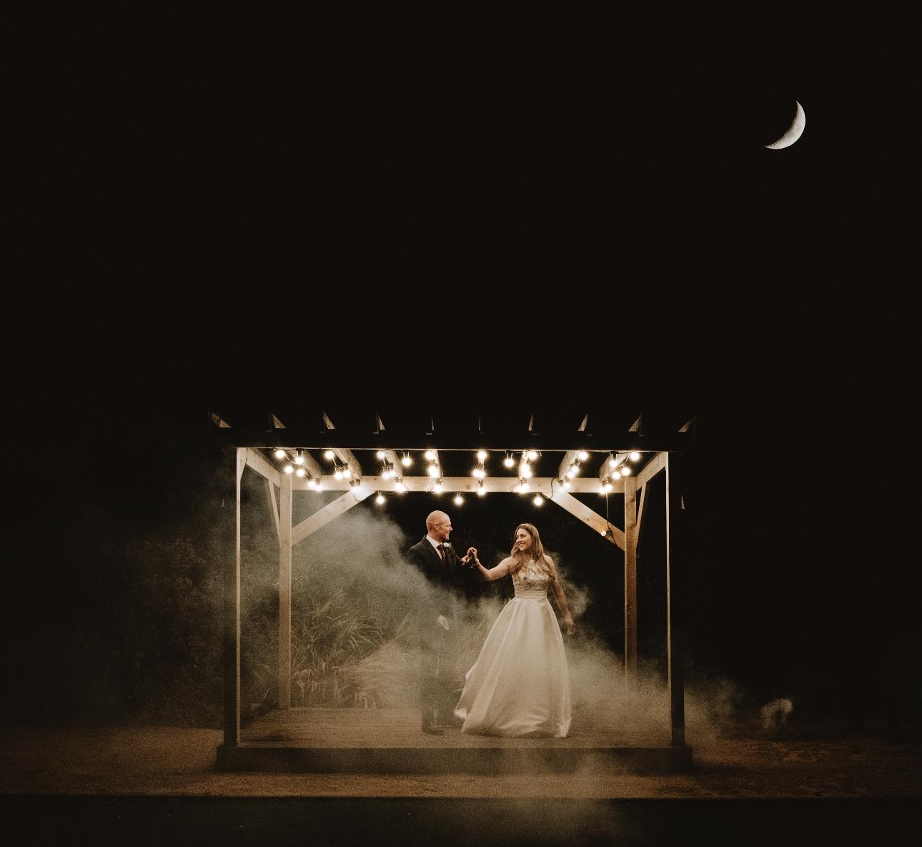 Newlyweds dance under lights