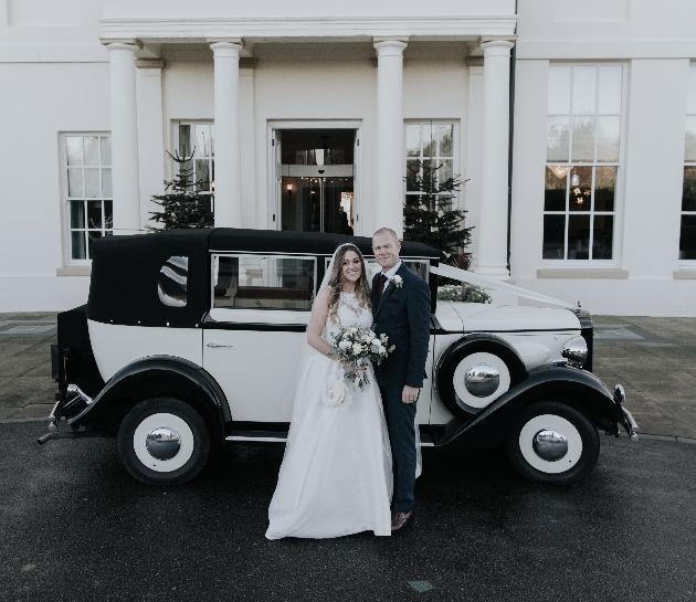 Couple and wedding car
