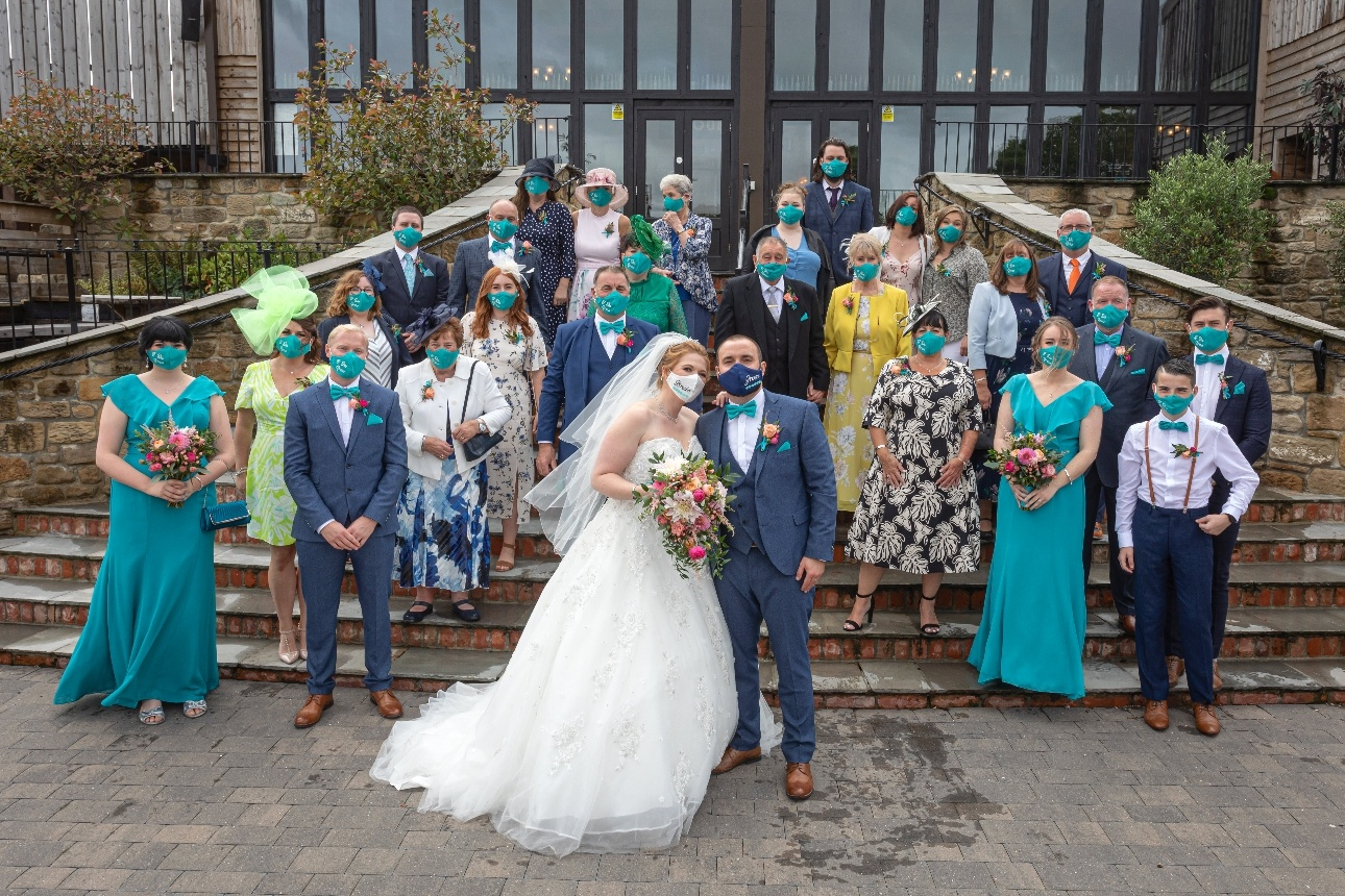 Wedding party wearing specially made masks