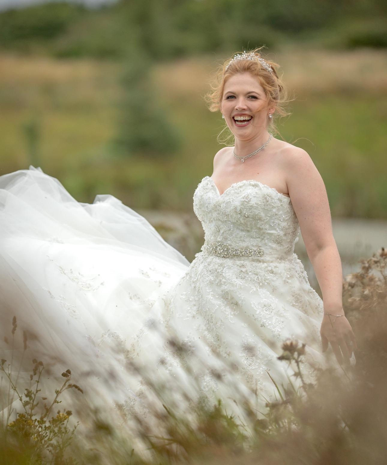 Bride's dress flowing in wind
