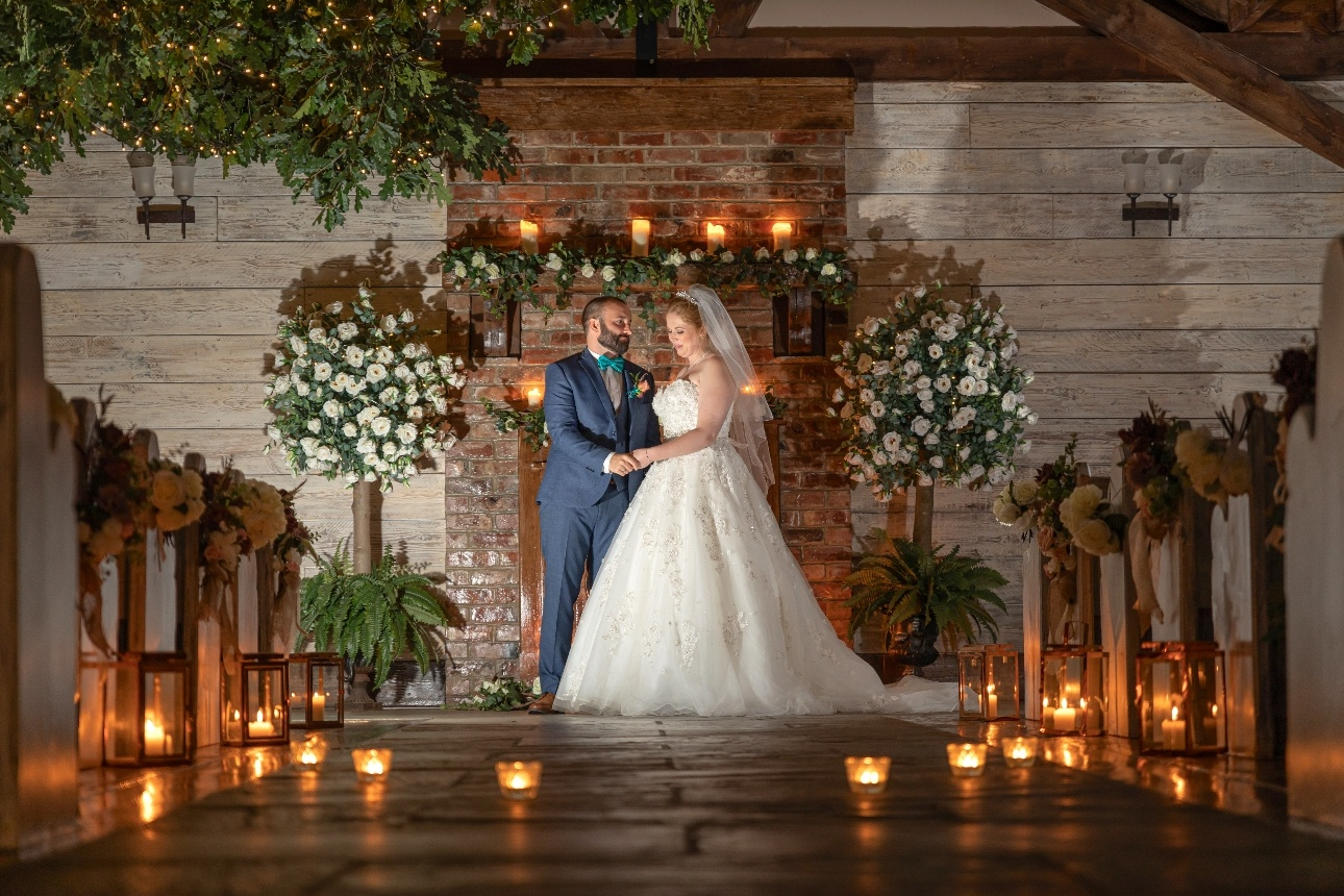 Newlywed couple pose in ceremony room