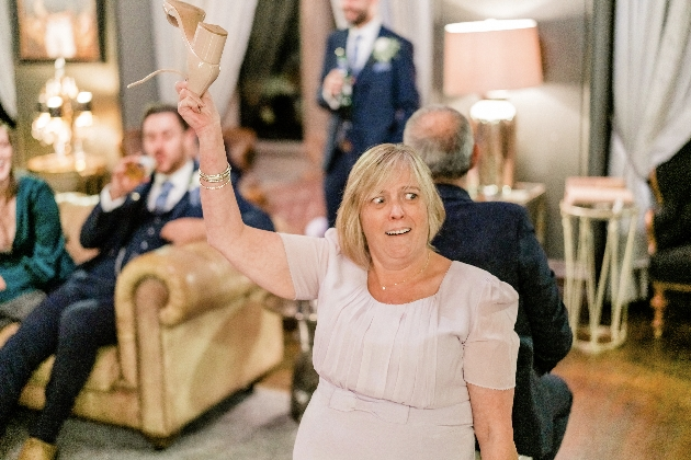 Lady removes shoes during wedding reception